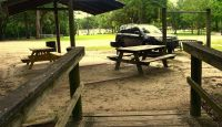 Myron b. Hodge City Park - parking, picnic table, grill, and entrance to boardwalk