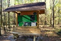 Wakulla State Forest accessible nature drive with interpretive kiosk and bench