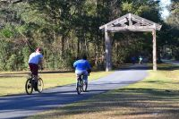 biking on trail at Wakulla Station Trailhead, St. Marks Historic Railroad State Trail