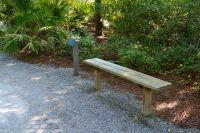Apalachicola National Estuarine Research Reserve Visitor Center - interpretation and bench along walkway